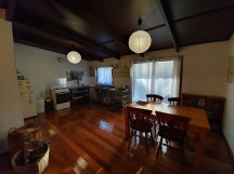 Tasmanian hardwood floors in the main living area and a fully equipped kitchen.